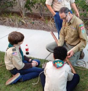 Teaching the conventional Diagonal Lashing to Boy Scouts at a troop meeting.