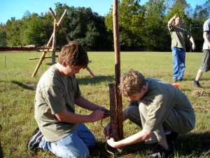 Scouts attach a 6' stave to a pioneering stake with two round lashings.