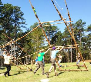 Scouts Hoist a Tall Gateway in Preparation for a Large Order of the Arrow Conclave