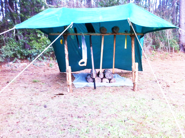 Protecting the tools from rain and providing a covered area for storage.