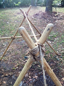 Support the A-frames with the rope attached to the legs and anchored to a stake on each side.
