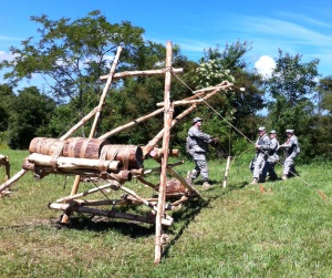 Soldiers play with Large Catapult